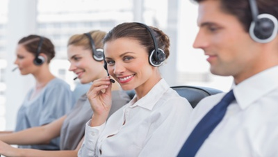 Attractive call centre agent with a headset
