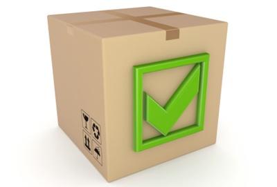 Green tick mark on a carton box.